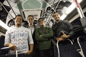 AS220 Youth photographed inside the newly wrapped bus with Providence Mayor Angel Taveras