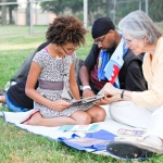 Reading together at Harriet & Sayles Park