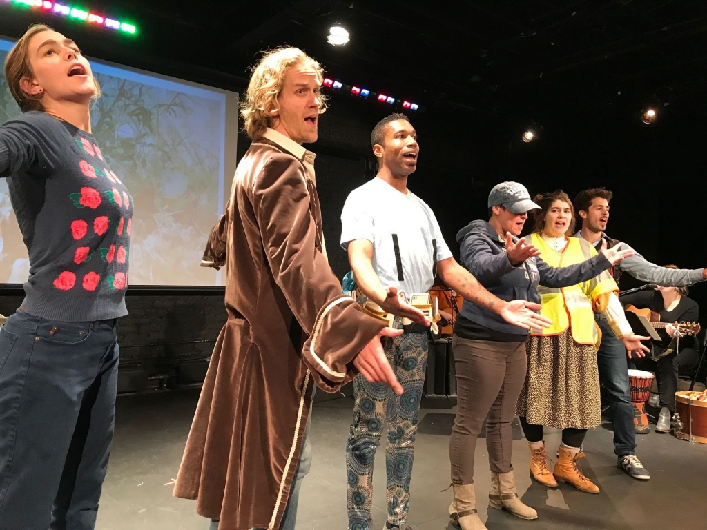Adult actors performing in Olneyville the Operetta by students from the Manton Avenue Project